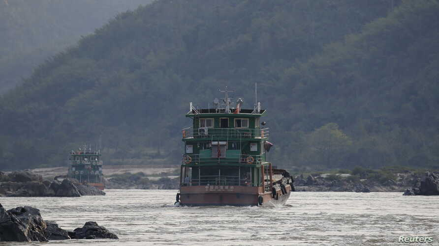Chinese cargo ships sail on the Mekong River near the Golden Triangle at the border between Laos, Myanmar and Thailand March 1, 2016.