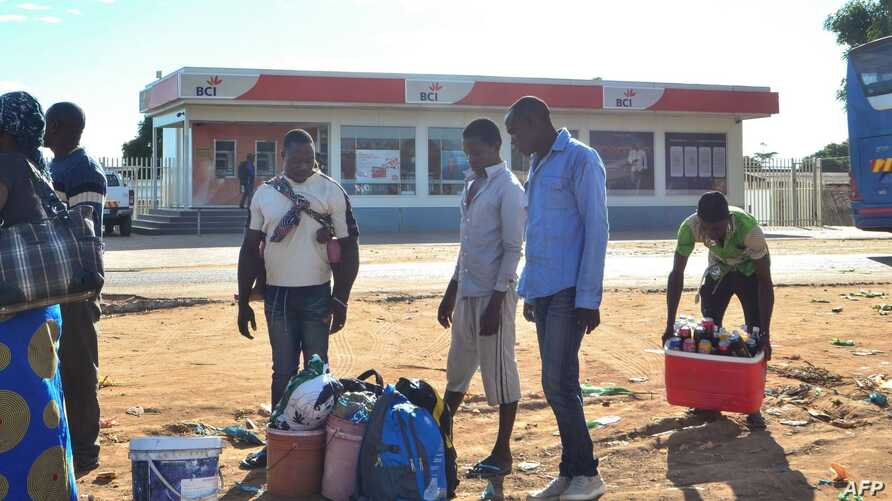 FILE - Street vendors prepare goods to sell in Macomia, northern Mozambique, June 11, 2018. A May 28 gunfight in the Cabo Delgado region between government soldiers and Islamist militants left at least 16 people dead and a dozen wounded.