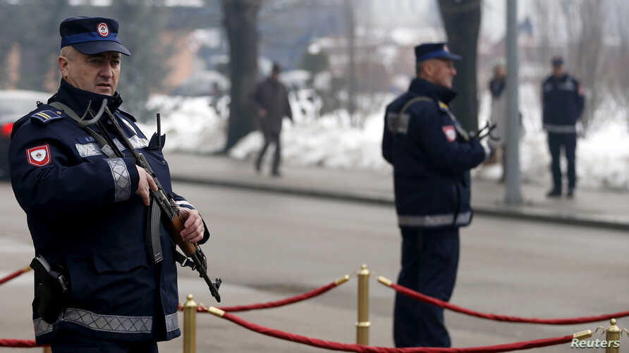 FILE - Serb police officers stand watch in Banja Luka in the Serb Republic part of Bosnia, January 09, 2015.