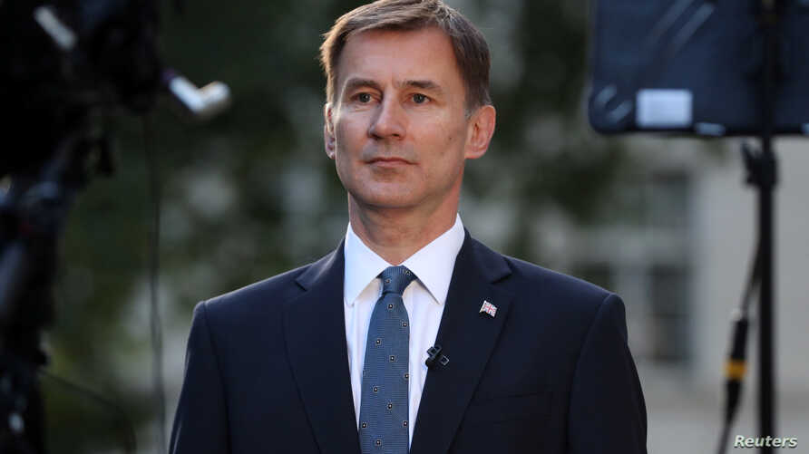 British Foreign Secretary Jeremy Hunt prepares to give an interview outside his home in London, Britain, June 24, 2019.