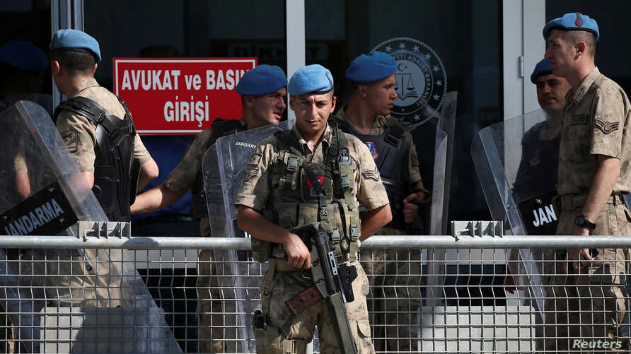 A Turkish soldier stands guard outside a courtroom at the Silivri Prison and Courthouse complex in Silivri near Istanbul, Turkey, June 24, 2019.