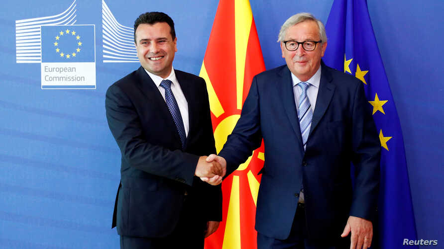 North Macedonia Prime Minister Zoran Zaev shakes hands with European Commission President Jean-Claude Juncker at the EU Commission headquarters in Brussels, Belgium, June 4, 2019.