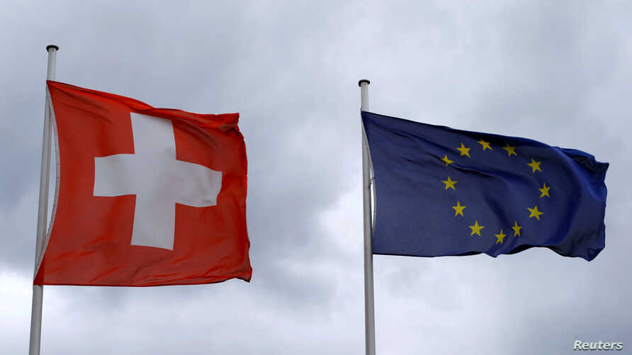 EU and Swiss flags near the German-Swiss border in Rheinfelden, Germany