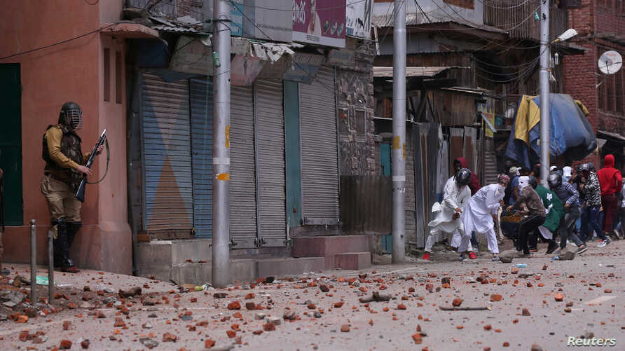 Demonstrators throw stones toward Indian police during clashes after the Eid al-Fitr prayers in Srinagar, India, June 5, 2019.