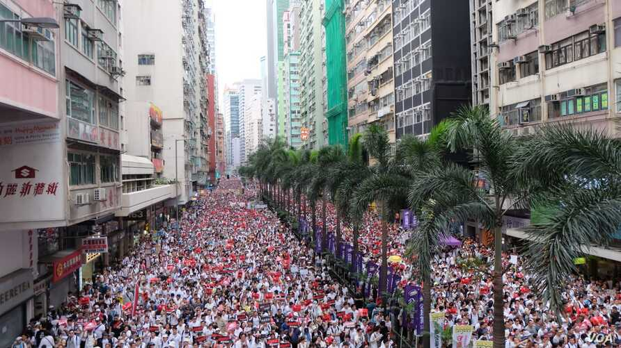 Hong Kong residents rally, June 9, 2019, against a proposed extradition law.