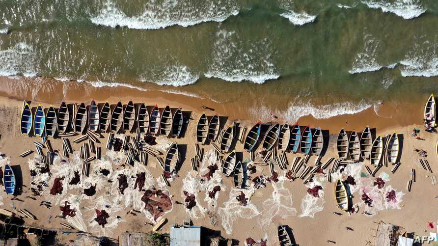 FILE - In this aerial view, fishing boats are seen on the shore of the Lake Malawi at the Senga village on May 20, 2019 in Senga, Malawi.