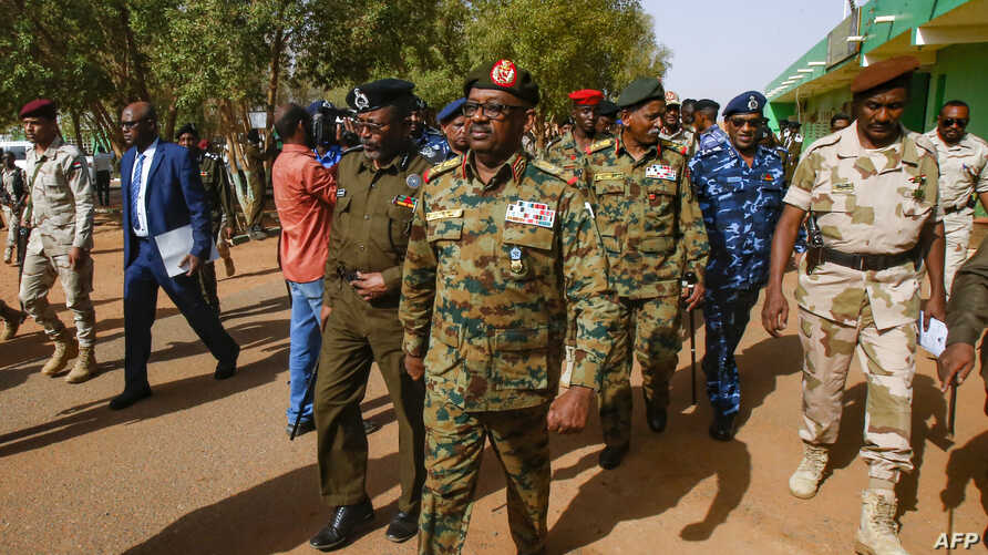 FILE - General Jamal Omar, center, a member of Sudan's Transitional Military Council (TMC), arrives in the capital Khartoum's twin city of Omdurman, July 4, 2019.