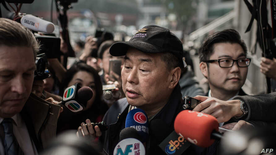 FILE - Outspoken media tycoon Jimmy Lai talks to the media after walking out of the Wanchai police station in Hong Kong, Jan. 21, 2015.