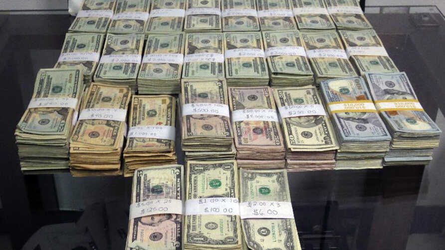 This 2014 U.S. Customs and Border Protection photo shows $189,300 in unreported U.S. currency seized from a Mexican man who attempted to smuggle the cash into the United States.