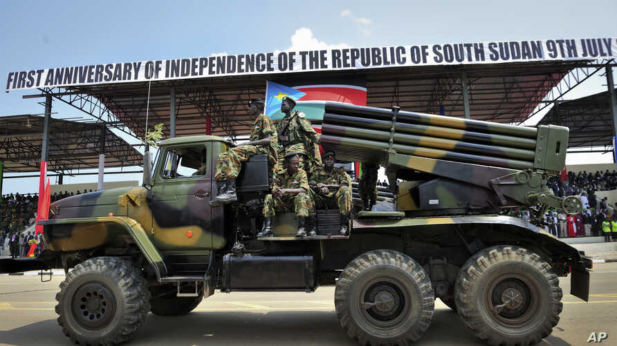 FILE - Members of South Sudan's military attend a parade at the country's first anniversary celebrations, at the John Garang Mausoleum in Juba, South Sudan, July 9, 2012.