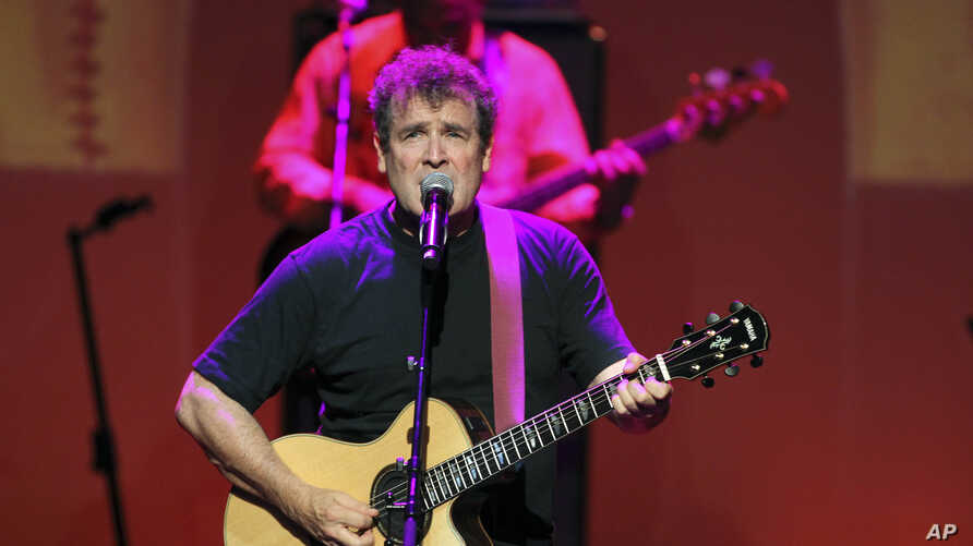 """FILE - South African singer Johnny Clegg performs during the """"South Africa Night Gala"""" at the Monte Carlo opera in Monaco, Sept. 29, 2012."""