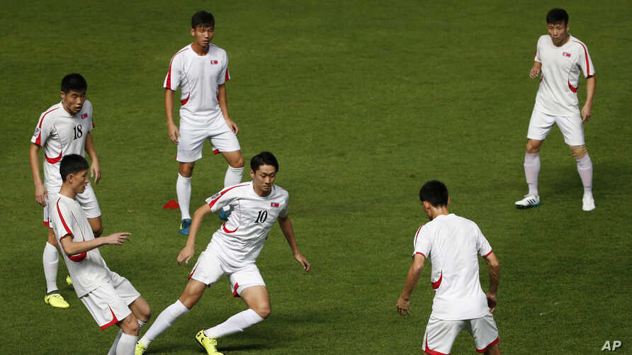 FILE - The North Korea national soccer team players train for the Asian Cup qualifiers, in Buriram province, Thailand, Nov. 9, 2017.