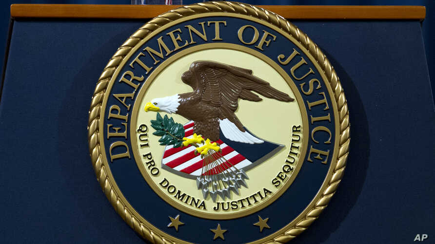 FILE - The Department of Justice seal is seen in Washington, Nov. 28, 2018.
