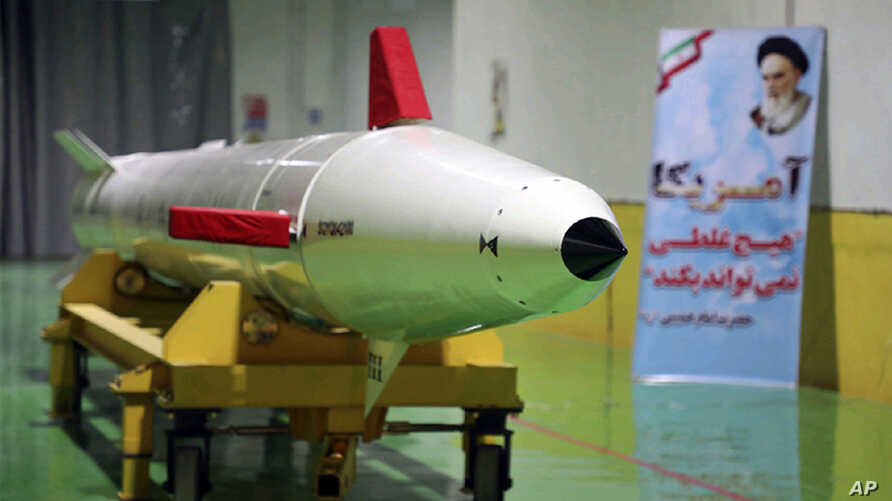 FILE - In this photo released Feb. 7, 2019, by Sepahnews, the website of the Iranian Revolutionary Guard, a Dezful surface-to-surface ballistic missile is displayed in an undisclosed location in Iran.