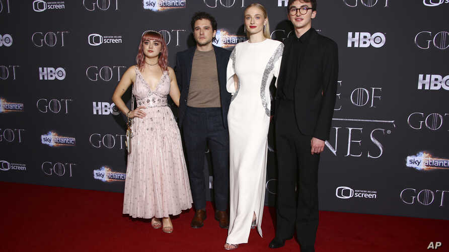 Actors Maisie Williams, from left, Kit Harington, Sophie Turner and Isaac Hempstead pose for photographers at the premiere of season eight of the television show 'Game of Thrones' in Belfast, Northern Ireland, Friday, April 12, 2019.