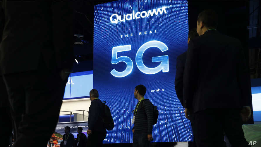 FILE- A sign advertises 5G at the Qualcomm booth at CES International in Las Vegas, Jan. 9, 2019.