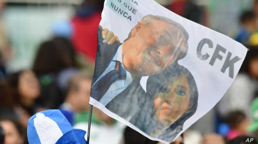FILE - Supporters of presidential candidate Alberto Fernandez and his running-mate, former President Cristina Fernandez, no relation, attend a campaign rally at the Nestor Kirchner Park, in Buenos Aires, Argentina, May 25, 2019.
