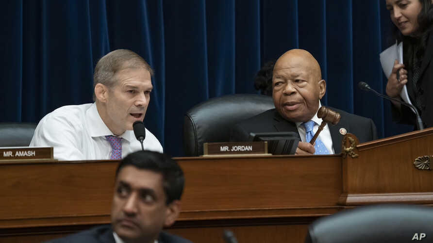 FILE - Rep. Jim Jordan, R-Ohio (L), the ranking member, makes a statement as House Oversight and Reform Committee Chairman Elijah Cummings, D-Md. (R), leads the vote to subpoena presidential counselor Kellyanne Conway, June 26, 2019.