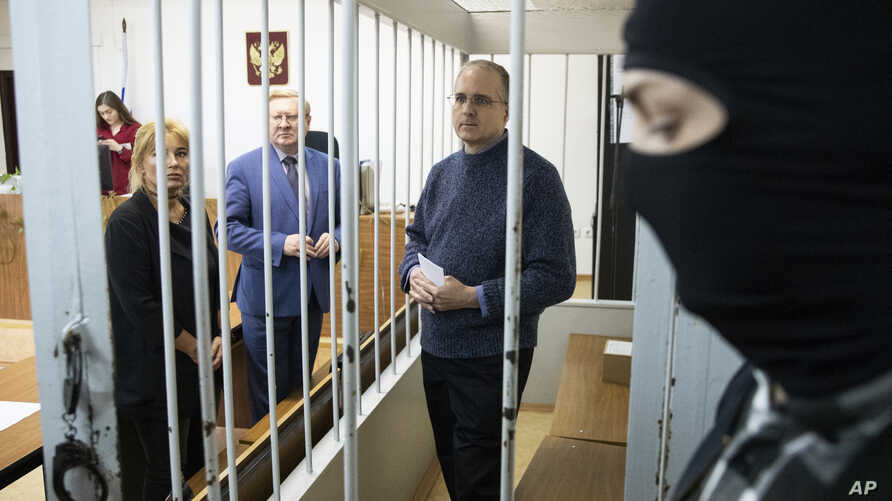 FILE - Paul Whelan, a former U.S. Marine, who was arrested for alleged spying in Moscow at the end of 2018, waits for a hearing in a court in Moscow, Russia, May 24, 2019.