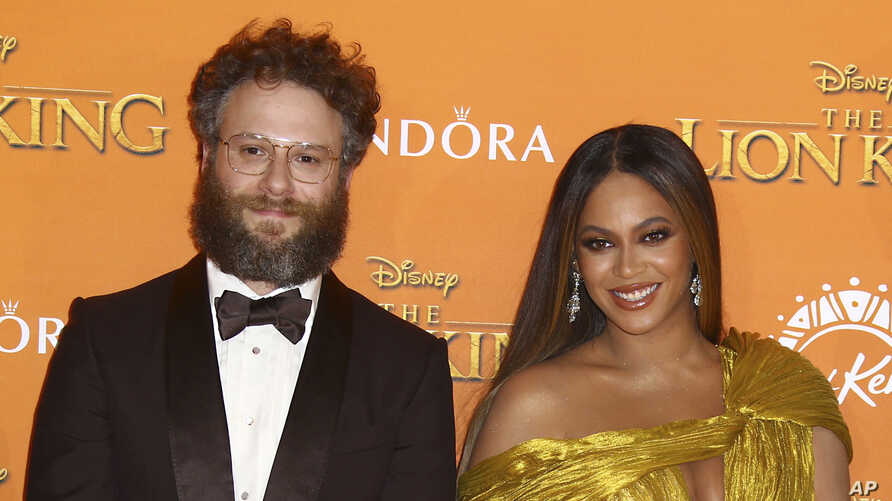 Seth Rogen and Singer Beyonce pose for photographers upon arrival at the 'Lion King' European premiere in central London, July 14, 2019.