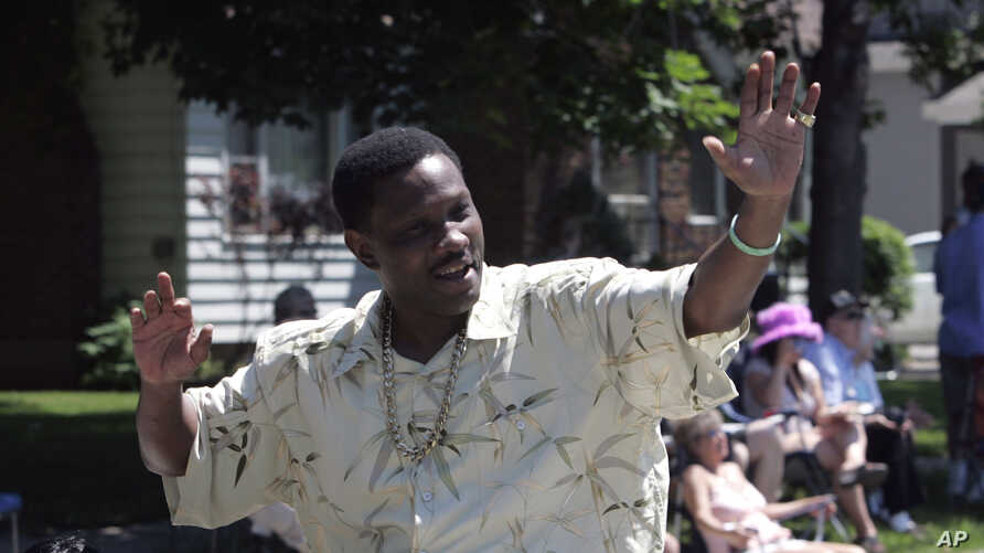 FILE - Pernell Whitaker waves to the crowd during a parade before he was inducted into the International Boxing Hall of Fame in Canastota, N.Y., June 10, 2007.