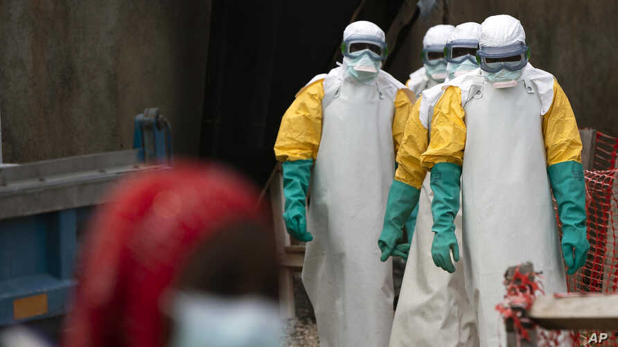 FILE - Health workers begin their shift at an Ebola treatment center in Beni, Democratic Republic of Congo, July 16, 2019. The Ebola outbreak has been declared an international emergency after it spread to eastern Congo's biggest city, Goma, this week.