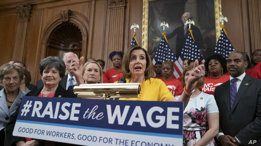 Speaker of the House Nancy Pelosi, D-Calif., joins fellow Democrats and activists seeking better pay as the House approved legislation to raise the federal minimum wage, at the Capitol in Washington, July 18, 2019.