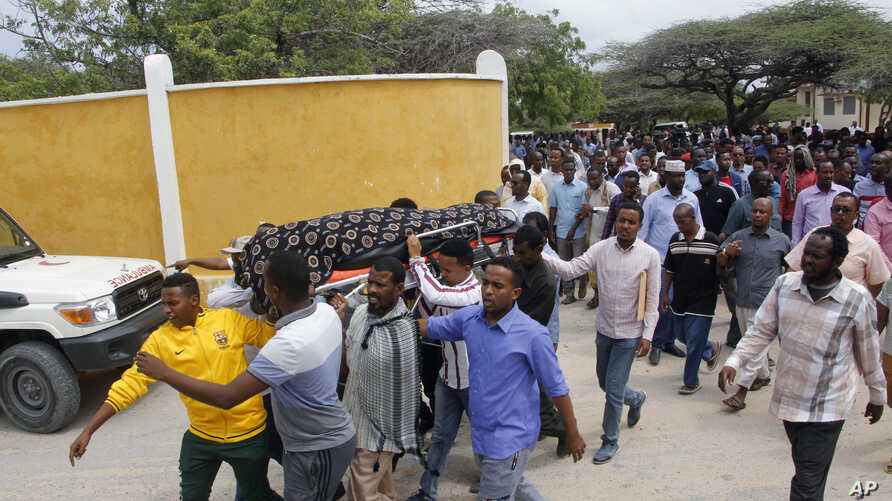 Mourners carry the body of the Chairwoman of the Shangani district, who was killed during an attack on Wednesday, in Mogadishu, Somalia, Thursday, July 25, 2019.