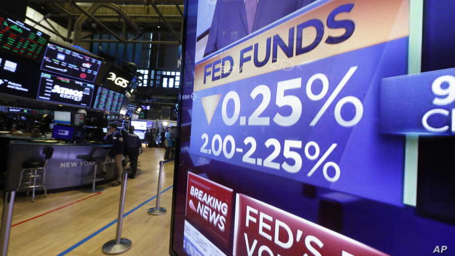 A television monitor on the floor of the New York Stock Exchange headlines the rate decision of the Federal Reserve, July 31, 2019.