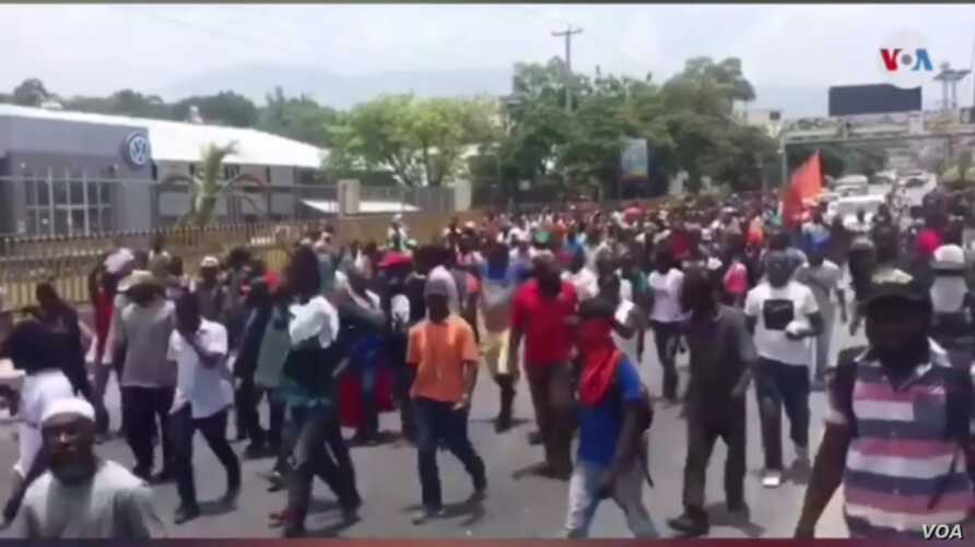 Protesters march pastUS Embassy in Port au Prince, Haiti, July 29, 2019.