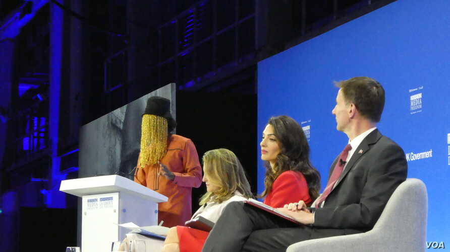 Ghanian journalist Anas Anas addresses the Global Conference for Media Freedom in London, July 10, 2019. Looking on are, (l-r) Canadian Minister for Foreign Affairs, Chrystia Freeland, UK Foreign Office Special Envoy on Media Freedom, Amal Clooney, and UK Foreign Secretary Jeremy Hunt.