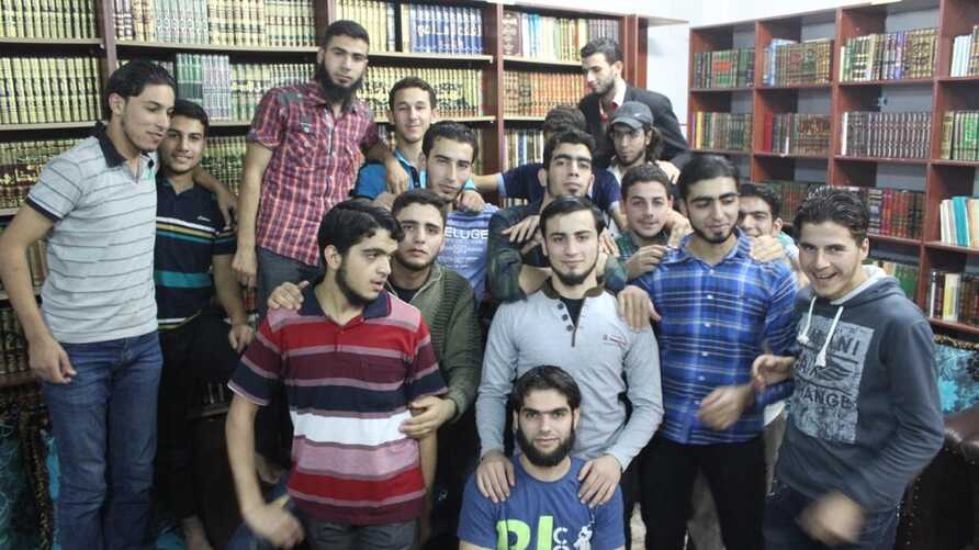 Some members of the secret library team gather in their underrground sanctuary in Daraya, Syria. (Photo courtesy of Ahmad Ma'dmani)