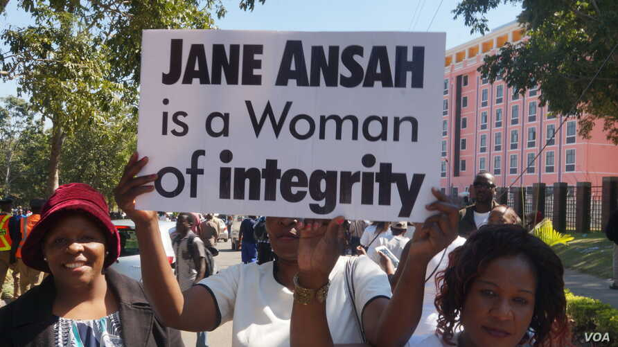 Protesters carry signs during a Jane Ansah solidarity march in Blantyre, Malawi, July 10, 2019. (Lameck Masina)