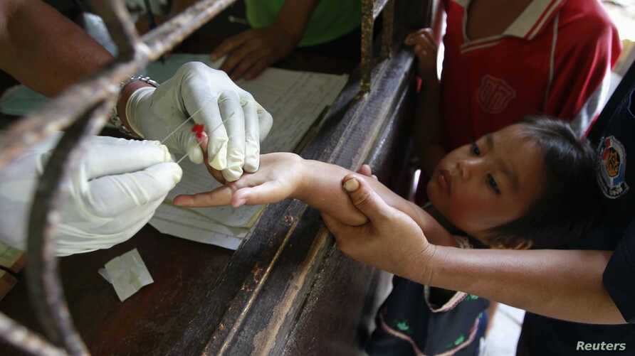 FILE - Children living in the Thai-Myanmar border come to a malaria clinic to get tested in Sai Yoke district, Kanchanaburi province, Thailand, Oct. 26, 2012.