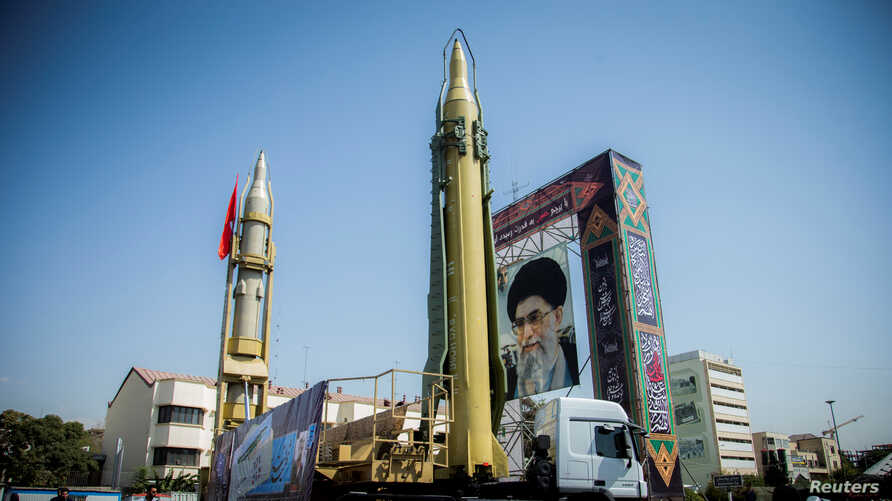 FILE - A display featuring missiles and a portrait of Iran's Supreme Leader Ayatollah Ali Khamenei is seen at Baharestan Square in Tehran, Iran, Sept. 27, 2017.