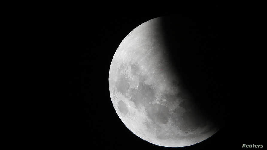 """The moon is seen during a lunar eclipse known as the """"Super Blood Wolf Moon,"""" in Manaus, Brazil, Jan. 21, 2019."""