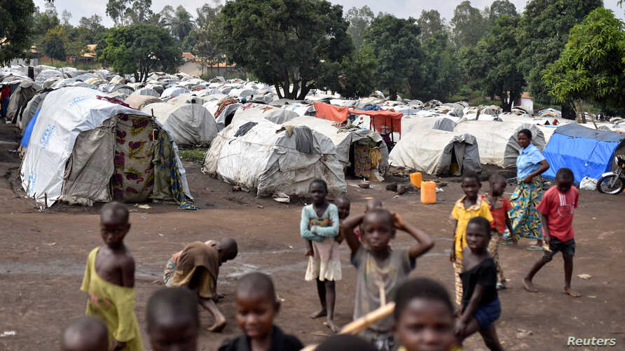 FILE - Congolese victims of ethnic violence are seen at a makeshift camp for the internally displaced people in Bunia, Ituri province in the eastern Democratic Republic of Congo, June 25, 2019.