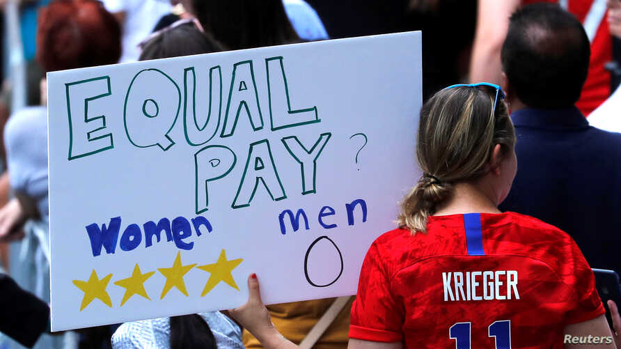 A fan displays a sign during the Women's World Cup Champions Parade in New York, July 10, 2019.