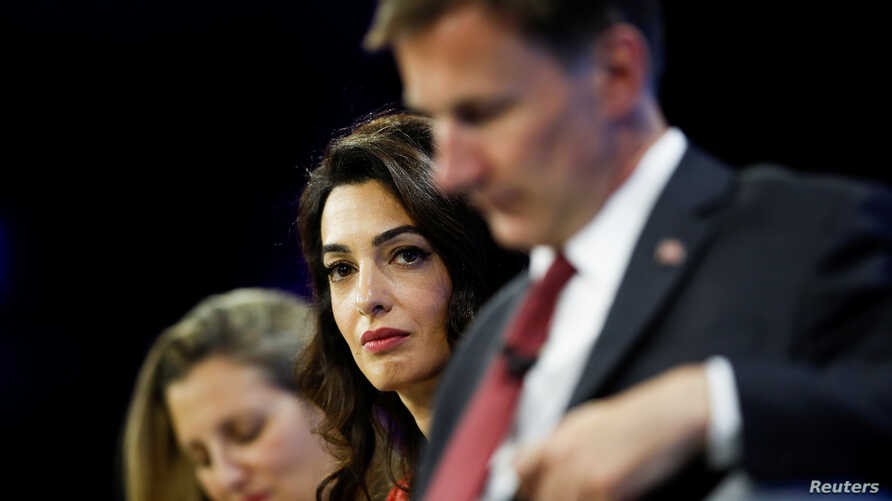 (L-R) Canadian Foreign Minister Chrystia Freeland, human rights lawyer Amal Clooney, and British Foreign Minister Jeremy Hunt listen to a question from a journalist during the Global Conference for Media Freedom in London, Britain, July 10, 2019.