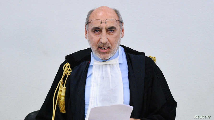 Court president Alfredo Montalto delivers the verdict in the case of an alleged people-smuggling kingpin identified as Medhanie Yehdego Mered, who claims his identity has been mistaken,  Palermo, Italy, July 12, 2019.