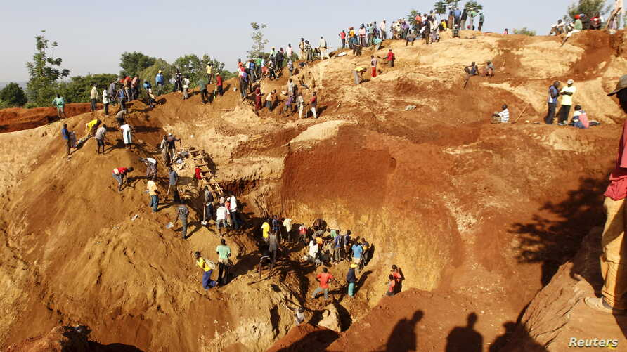 FILE - Gold prospectors work at an open pit in the village of Nyang'oma Kogelo, west of Kenya's capital Nairobi, July 15, 2015.