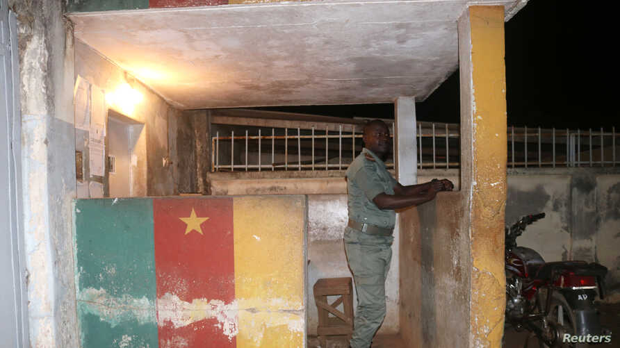 FILE - A security forces member stands guard at prison in Yaounde, Cameroon, Sept. 1, 2017.