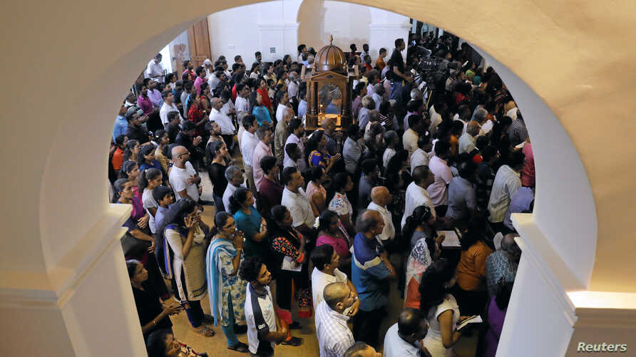 FILE - Devotees pray during the reopening ceremony of the St. Anthony's Shrine, one of the churches attacked in the April 21st Easter Sunday bombings in Colombo, Sri Lanka June 12, 2019.
