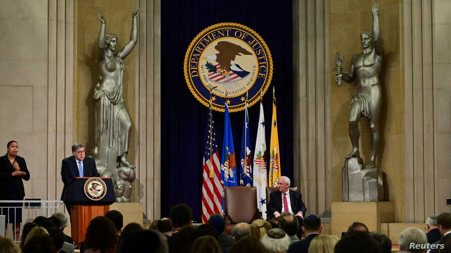 U.S. Attorney General William Barr, joined by Deputy Attorney General Jeffrey A. Rosen, delivers opening remarks at a summit on Combating Anti-Semitism at the Justice Department in Washington, July 15, 2019.