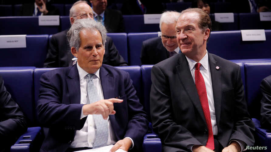 "World Bank President David Malpass (R) and International Monetary Fund (IMF) Deputy Managing Director David Lipton attend a conference entitled ""Bretton Woods: 75 years later"" in Paris, France, July 16, 2019."