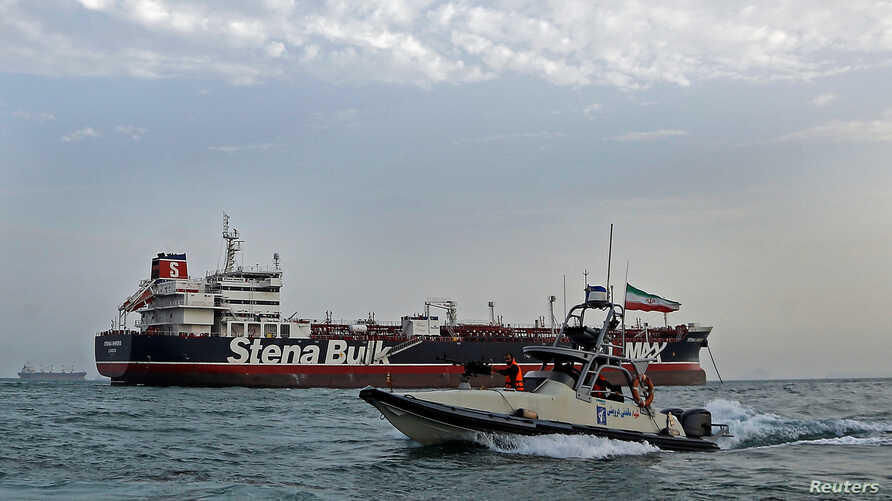 A boat of Iranian Revolutionary Guard sails next to Stena Impero, a British-flagged vessel owned by Stena Bulk, at Bandar Abbas port, July 21, 2019.