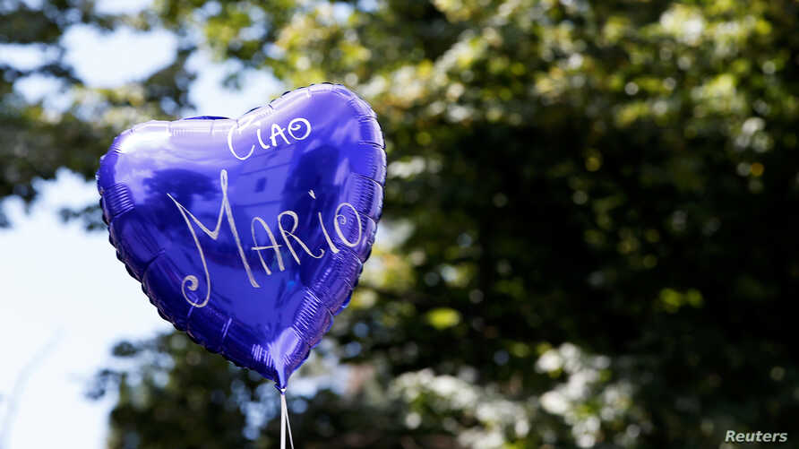 A balloon reading 'Ciao Mario ('goodbye Mario') is seen outside the church of Santa Croce before the funeral of slain Carabinieri military police officer Mario Cerciello Rega, in his hometown Somma Vesuviana, Italy, July 29, 2019.
