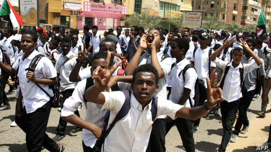 Sudanese students protest in the capital Khartoum, July 30, 2019, a day after teenagers were shot at a rally against shortages of bread and fuel in the town of al-Obeid, about 420 kilometers southwest of the capital.