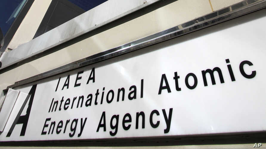 A sign marks the building of the International Atomic Energy Agency, IAEA, in Vienna, Austria, March 5, 2013.