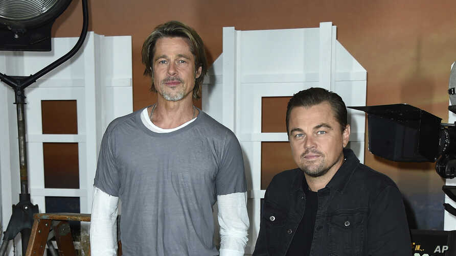 """FILE - Brad Pitt, left, and Leonardo DiCaprio at the photo call for """"Once Upon a Time in Hollywood"""" in Los Angeles, July 11, 2019."""